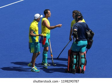 GOLD COAST, AUSTRALIA - APRIL 03, 2018 : Mark Knowles (2ND L) of Australia in action during Men Hockey match Gold Coast 2018 Commonwealth Games at Gold Coast Hockey Centre.