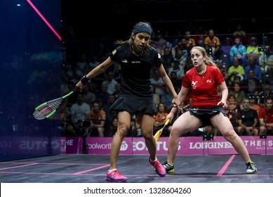 GOLD COAST, AUSTRALIA - APRIL 09, 2018 : Nicol David (left) of Malaysia competes with Colette Sultana of Malta during Squash event Gold Coast 2018 Commonwealth Games.