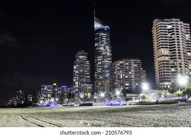 GOLD COAST, AUSTRALIA - AUGUST 12 2014: Gold Coast City, Surfers Paradise  cityscape by night with Q1 building and famous beach