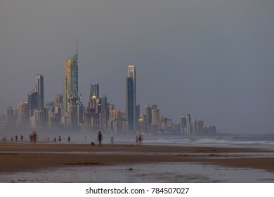 GOLD COAST, AUSTRALIA - DECEMBER 30 2017: Surfers Paradise Gold Coast cityscape and people walking the beach, view from Miami beach.