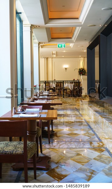 GOLD COAST, AUSTRALIA - DECEMBER,2018: Dining tables prepared for lunch in Versace Hotel, the world's first fashion branded hotel, located by the Southport Broadwater in Main Beach.