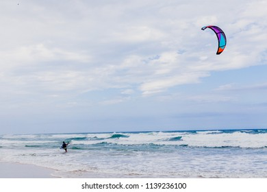 GOLD COAST, AUSTRALIA - January 14th, 2015: kitesurfers at the beach in Surfers Paradise and Pacific Ocean waves