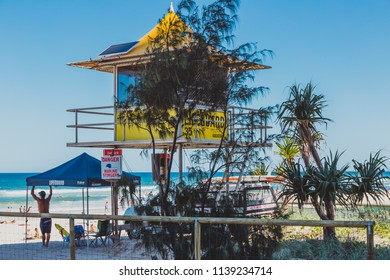 GOLD COAST, AUSTRALIA - January 16th, 2015: lifeguard beach hut on the beach in Surfers Paradise surrounded by tropical bushes