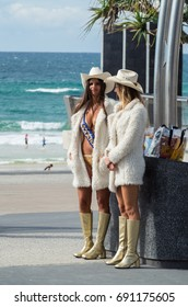 Gold Coast, Australia - July 11, 2017: Gold Coast meter maids in Surfers Paradise. Meter maids are employed as tourist guides.