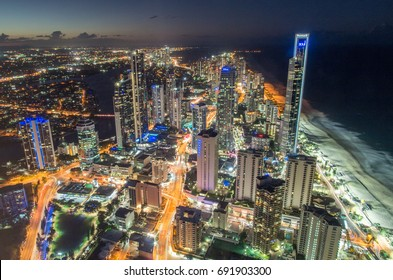 Gold Coast, Australia - July 11, 2017: View north along the Gold Coast, Australia from the Q1 building Skydeck in Surfers Paradise at night, with glistening city lights.