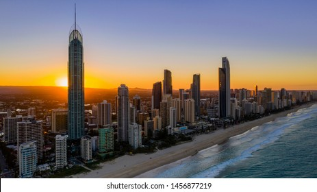 GOLD COAST, AUSTRALIA - June 22 2019: Aerial sunset silhouette on the on the Q1 building, with a view of the Surfers Paradise skyline and beach.