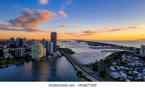GOLD COAST, AUSTRALIA - MAY 05 2019: Aerial view over sundale bridge and Gold Coast surrounds, with colorful clouds in the sky at sunrise