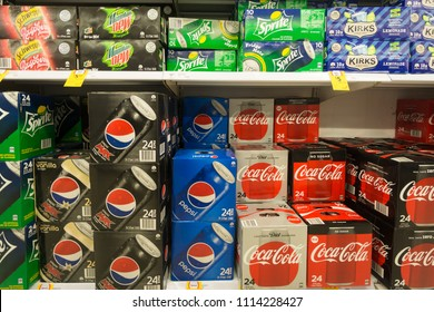 Gold Coast, Australia - May 09 2018: Boxes of soda  from various brands such Coca Cola, Sprite and Pepsi as are displayed in a supermarket.