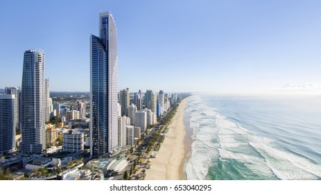 GOLD COAST, AUSTRALIA - MAY 23 2017: High aerial view of Surfers Paradise cityscape and coastline at sunrise.