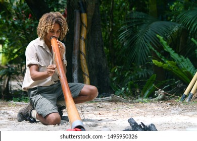 Gold Coast Australia on January 2, 2011. A local showing how to use a traditional instrument called a Didgeridoo.