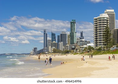 Gold Coast, Australia - September 22, 2016: View of tourists at the Surfers Paradise beach with skyscrapers during daytime.