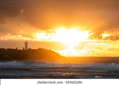 Gold Coast Australia - Southport Spit, close up of sunrise over the breakwall