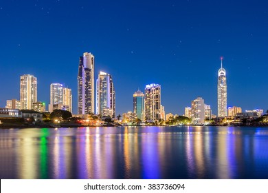 Gold Coast Beautiful Panorama Night view Skyline under Clear Blue Sky Illuminated Q1, CBD and Cityscape With Reflection In The Calm River Water, Surfers Paradise, Queensland, Australia