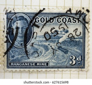 GOLD COAST - Circa 1950: A postage stamp from Ghana (formerly Gold Coast) depicting King George VI and an illustration of a manganese mine.