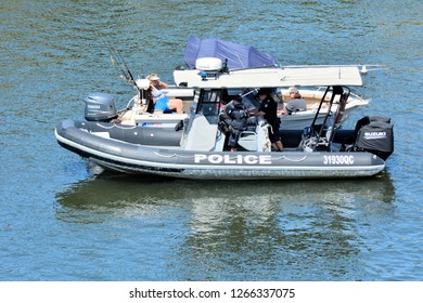 GOLD COAST - DEC 18 2018:Australian Police patrol boat checks motor boats on the rivers of Gold Coast, Queensland, Australia