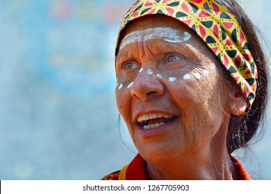 GOLD COAST - DEC 19 2018:A proud mature indigenous Australian woman singing in a cultural show.The Aboriginal and Torres Strait Islander culture consider as the most ancient in the world.