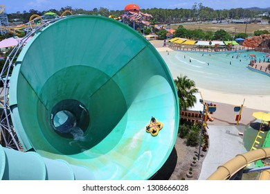 GOLD COAST- JAN 30 2019:People ride on a water slide named Green Room in White Water World, Gold Coast, Australia