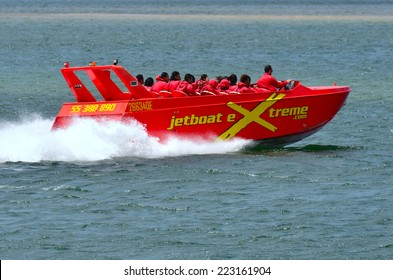 GOLD COAST - OCT 09 2014:Visitors during a Jet Boat Rides in Gold Coast Queensland Australia.It's the fastest speedboat in Gold Coast with the capacity to cruise 40 knot blast.