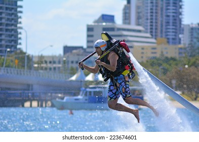 GOLD COAST - OCT 12 2014: Man ride a Jet pack.It can runs at 45 to 50 km/h (27 to 31 mph).