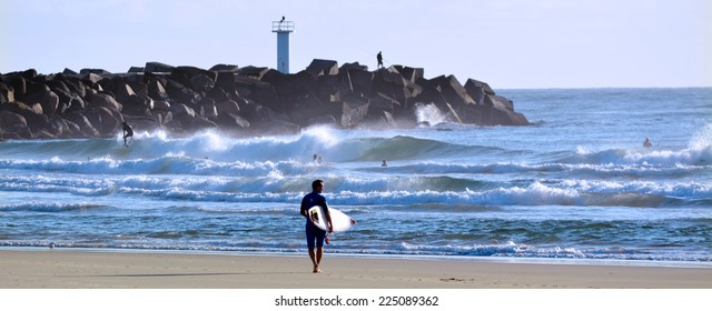 GOLD COAST - OCT 13 2014: Surfers in the Spit beach.It is a very popular surfing beach in Surfers Paradise Gold Coast Queensland, Australia.