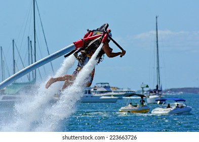 GOLD COAST - OCT 14 2014: Man ride a Jet pack.The concept emerged from science fiction in the 1920s and became popular in the 1960s as the technology became a reality.