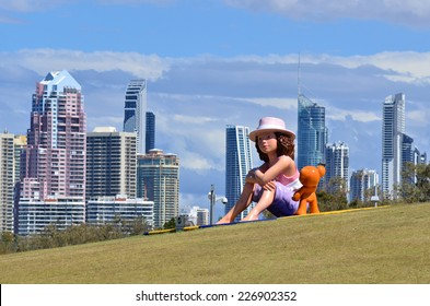 GOLD COAST - OCT 16 2014: Fibreglass sculpture of a child and her teddy bear in THE HILL at Southport Broadwater Parklands in Gold Coast Queensland Australia.It's  a 2.5-metre (8 ft 2 in) high.