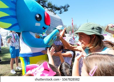 The Gold Coast, Queensland, 6th April 2018, The Commonwealth Games mascot Borobi gives children a high five.