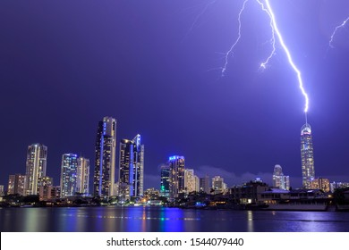 Gold Coast, Queensland / Australia - February 13 2018: Q1 and Gold Coast buildings being struck and surrounded by lightning during large thunderstorm in storm season