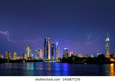 Gold Coast skyline being lit up with a creeper lightening bolt, view from Evandale. Park