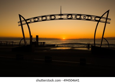 GOLD COAST, SURFERS PARADISE - AUGUST 26 2016: Gold Coast Surfers Paradise centre - silhouette looking out towards the sunrise over the ocean.