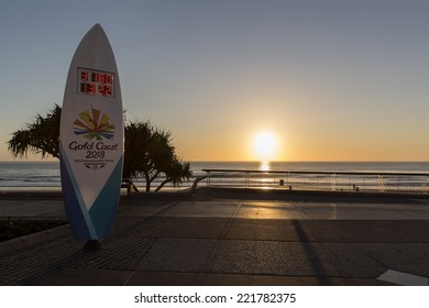 GOLD COAST, SURFERS PARADISE - OCTOBER 6 2014: The 2018 Commonwealth Games countdown clock shaped as a surfboard is four meters tall - silhouette. Taken at sunrise