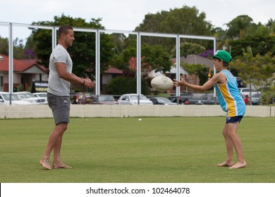 GOLD COAST-MARCH 11: GC Titans rugby team captain Scott Prince appeared on charity Cricket Match at Austar show grounds. He did practice session with kids on March 11, 2012 on Gold Coast, Australia.