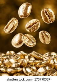 Gold coffee beans on brown background falling down