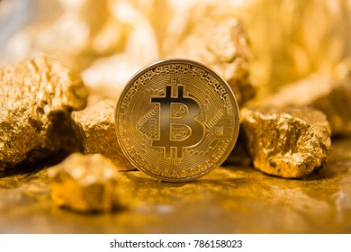 Gold coin Bitcoin. a mound of gold. Bitcoin-Crypto currency. Isolated on a gold background. Business concept.