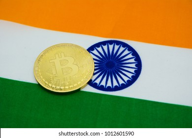 gold coin bitcoin on a background of a flag India