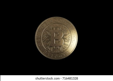 Gold coin Bitcoin on a black background. The concept of crypto currency. Blockchain technology.