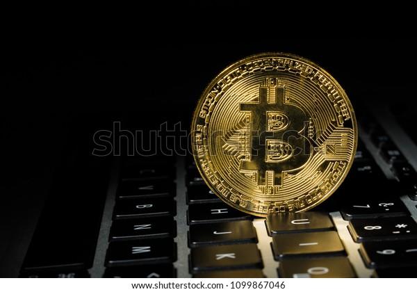 Gold coin bitcoin on the keyboard