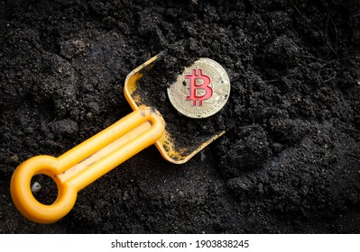 gold coin bitcoin with shovel in soil digital money cryptocurrency concept