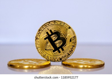 Gold coin bitkoyn stacked on a light background close-up. Bitcoin-crypto currency