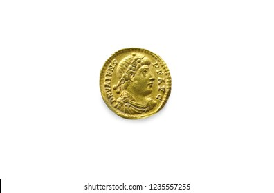 Gold coin depicting the Eastern Roman Emperor Valente. Isolated over white