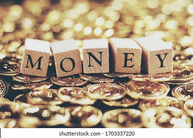Gold coin and money letter block