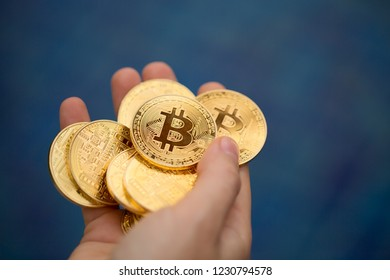 gold coin, silver coin, on a green, blue, black background. cryptocurrency.