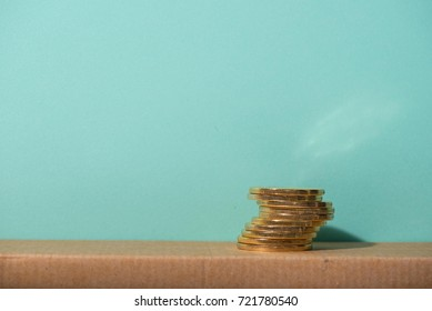 gold coin stack with green background