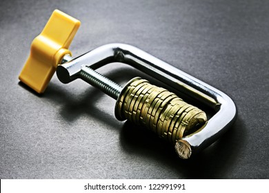 Gold coins in clamp. Selective focus.
