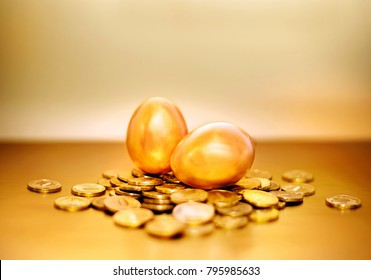 Gold coins and golden eggs, the concept of financial growth.
