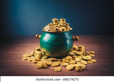gold coins in a green pot on a dark background
