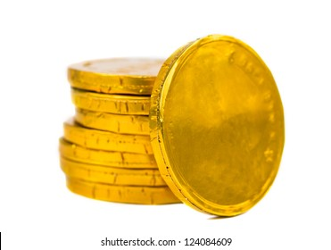 Gold coins isolated on white background