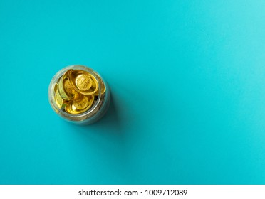 Gold coins on blue paper background,Chinese new year concept,Minimal creative style.