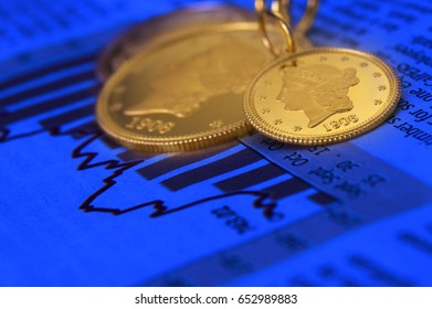 Gold coins on graphical chart with blue background