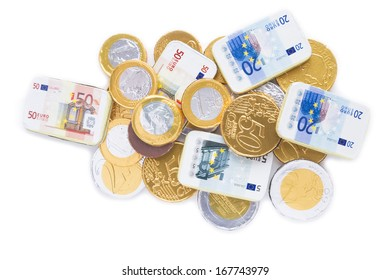 Gold coins of one euro, on a white background